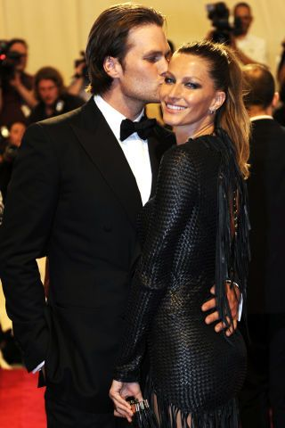 Model Gisele Bundchen and football superstar Tom Brady at the 2010 Met Gala, 'American Woman: Fashioning a National Identity.'