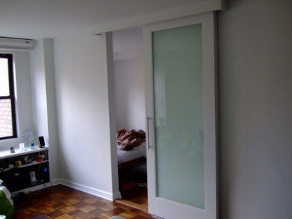 Frosted glass slider...36x80...hmm, use 2? might make it seem more 'open' instead of keeping those wood folding doors.
