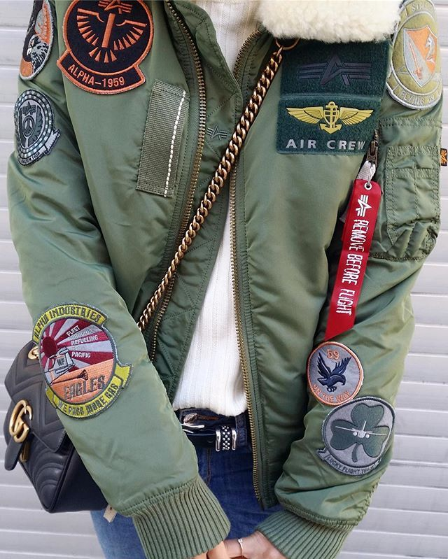 Injector III bomber jacket with patches by Alpha Industries.