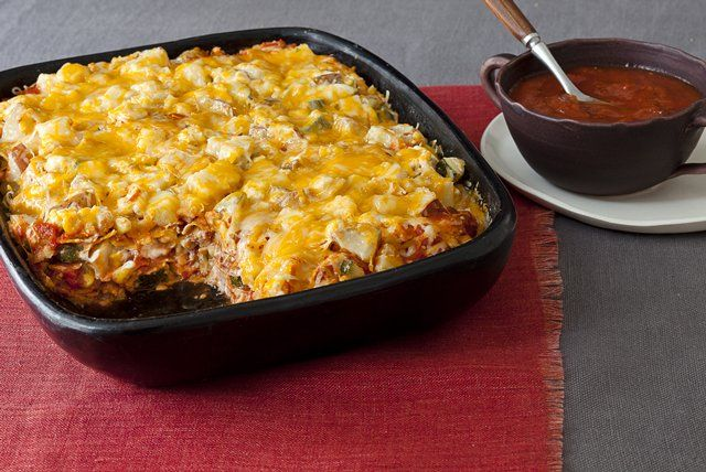 Made with a mix of cheeses and all kinds of veggies, this potluck-perfect tortilla casserole is just layer after layer of crowd-pleasing deliciousness.