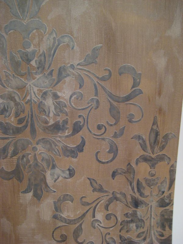 Venetian Plaster the bathroom walls and layer a motif using a stencil and plaster for depth around the room.