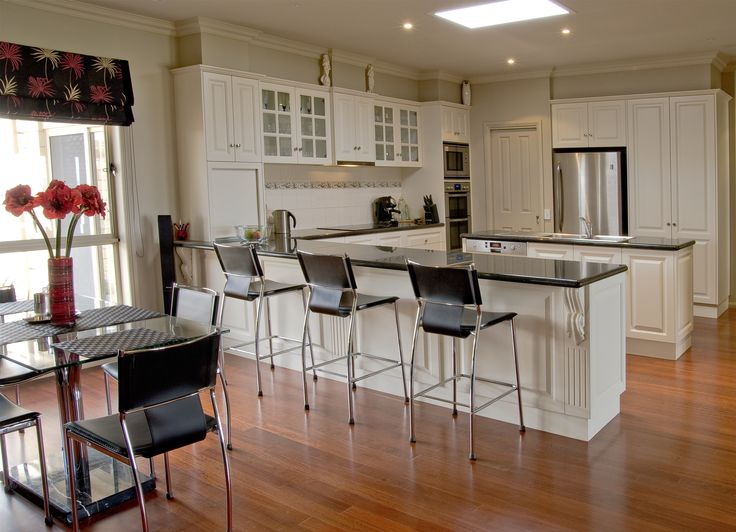 Traditional kitchens with classic fluted panels and corbels