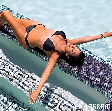 Kris Jenner is loving 2014 so far! The separated 58-year-old momager shared a series of family photos on Instagram Monday, Jan. 7 using Flipagram, which showed off her fabulous life -- and impressive bikini body.