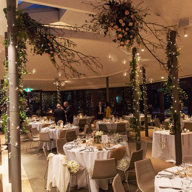 suspending florals - wedding reception - magnolia/roses/aneomes/ivy wrapped poles and twinkling lights - soft and pretty