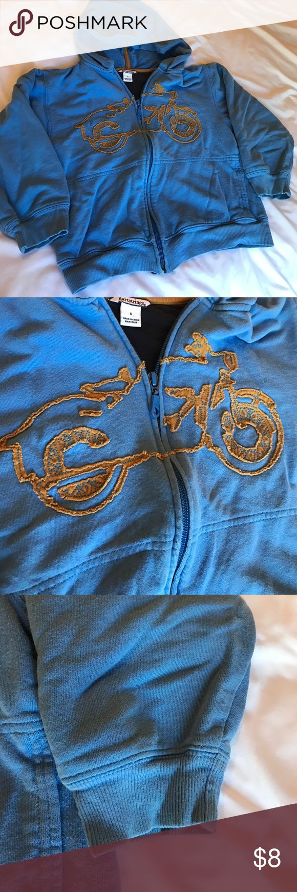Blue Hoodie with Motorcycle Appliqué Really cute blue zip up hoodie with motorcycle appliqué in brown. Great condition with minor fading and wear on sleeves. Hartstrings Shirts & Tops Sweatshirts & Hoodies
