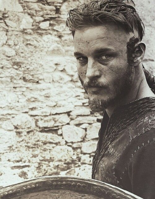 Travis Fimmel as Ragnar Lothbrook in Vikings. Saw some picks of him younger and model-y...the dirt, the roughness...WAY hotter.