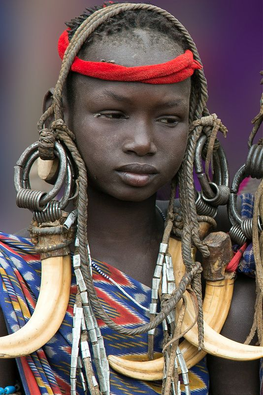 Turkana community who lives in Kenya. They dress this way during wedding ceremony.