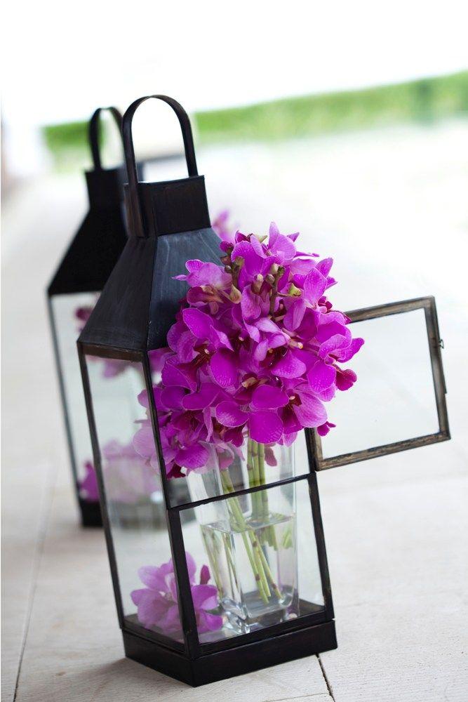 Bouquet peeking out of lantern by Tirtha Bridal Uluwatu Bali
