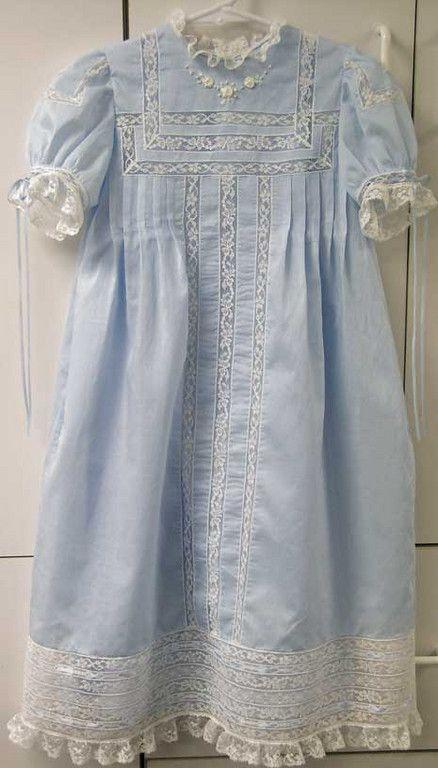 :)Lace insertion . Beautiful blue little girls dress.