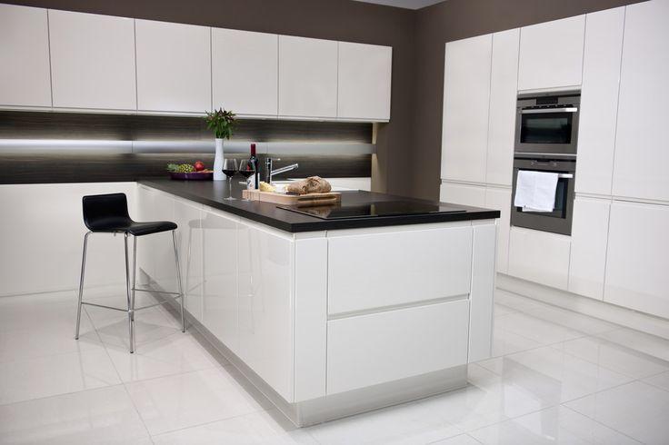 Monochrome magic – white hi-gloss units with striking black worktops from habitat's new fitted kitchens range