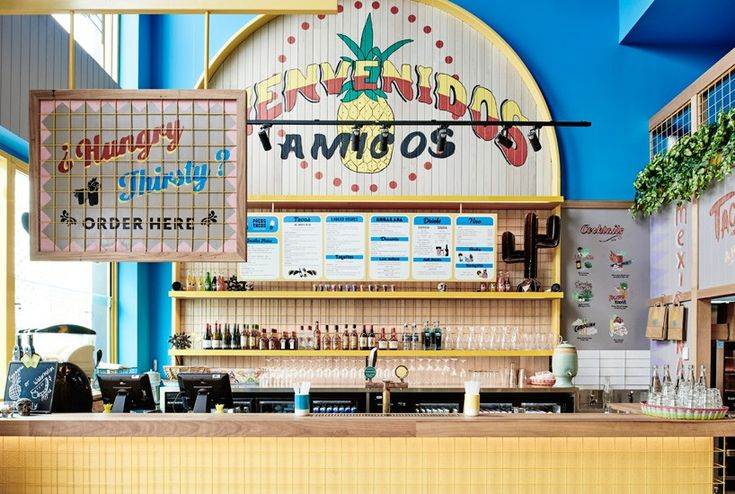 the playful mexican eatery in australia features a vibrant and colorful interior, while instilling a courtyard-like ambience.
