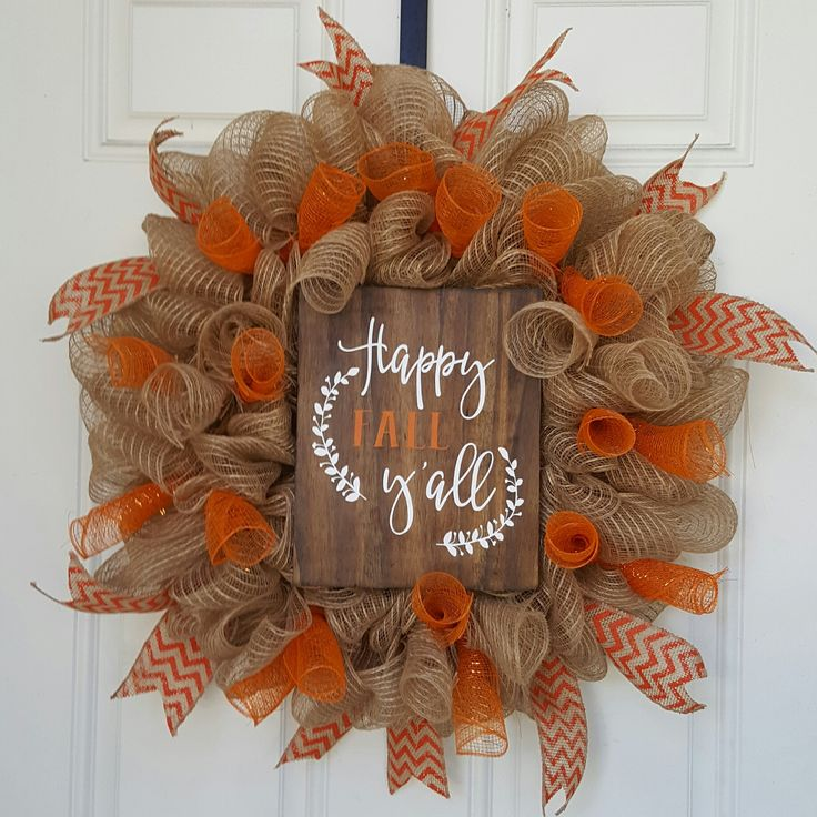 "Beautiful and Full Deco Mesh Wreath averaging 22"" in diameter. Accented with Orange Deco swirls and Orange Chevron ribbon. Attached in the middle is a handcrafted wooden sign that states ""Happy Fall Y"
