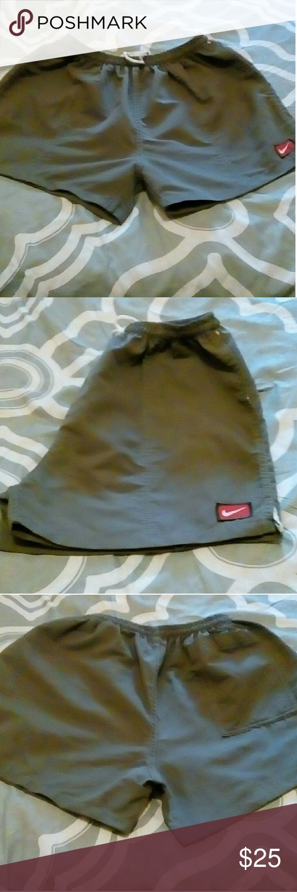 Nike shorts Nike short use once  size one size fit all great for jogging or use as beach shorts. Elastic waist string tie two front pocket one back pocket very cute Nike Shorts
