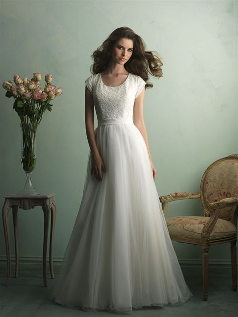 Embroidery covers this gown's cap sleeved bodice, while layers of English net compose the soft A-line skirt.  See store for availability and pricing.