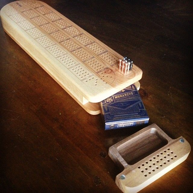 Custom cribbage board with pocket for cards and peg storage. #cnc #laser
