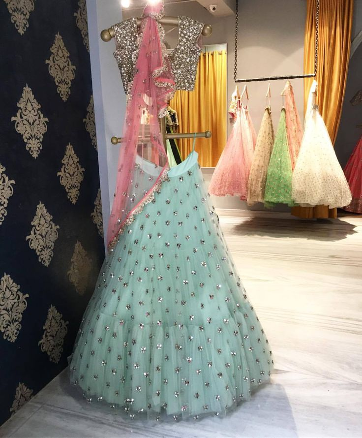 Beautiful powder blue color designer lehenga and gold crop top with pink color net dupatta from banjara collection of Mrunalini Rao.Shop these at bridal asia . 05 September 2017