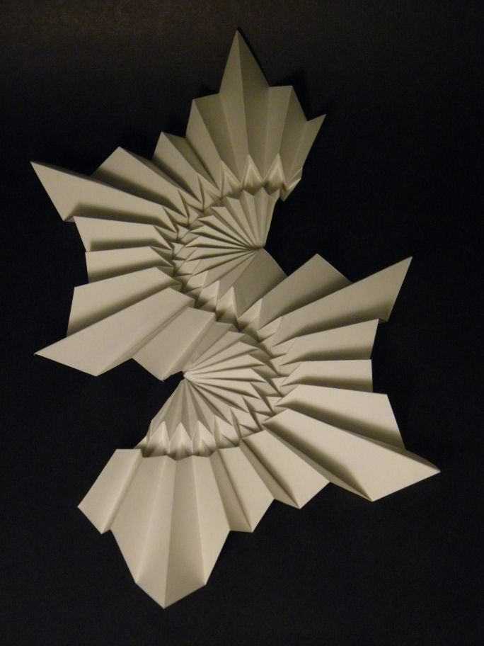 https://flic.kr/p/bvz9E3   S-Curve - Ray Schamp   18,8cm x 28,1cm Drawing paper  I love all the  Ray Schamp models I folded, but this one is (at least by now) my favorite.  Ray Schamp really is a great designer that deserves to be better known!   CP: www.flickr.com/photos/19009479@N00/1448959823  Thanks for sharing,  Ray Schamp!!
