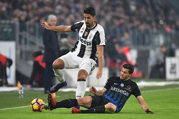Sami Khedira (L) of Juventus FC is tackled by Remo Freuler of Atalanta BC during the Serie A match between Juventus FC and Atalanta BC at Juventus Stadium on December 3, 2016 in Turin, Italy.