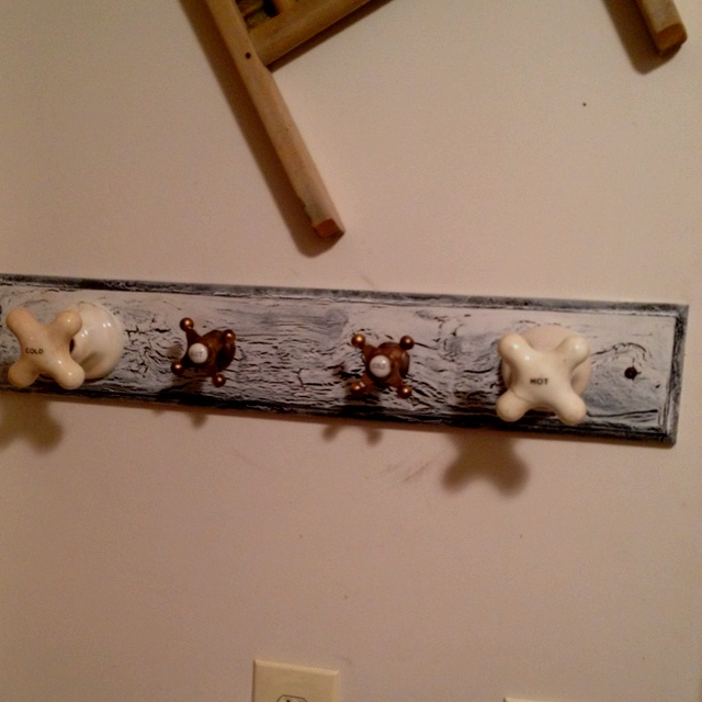Homemade towel holder made from pine board homemade crackle paint and antique hot n cold knobs!