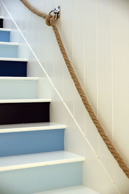 Fun idea for leading to a widow's walk, cellar or another casual space in a beach home - multi-colored blue stairs, rope handrail.