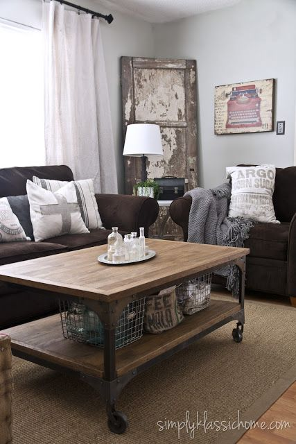 brown couches and industrial/vintage style. wall color: Owl Grey by Benjamin Moore totally my style. Can't wait to paint our living room!
