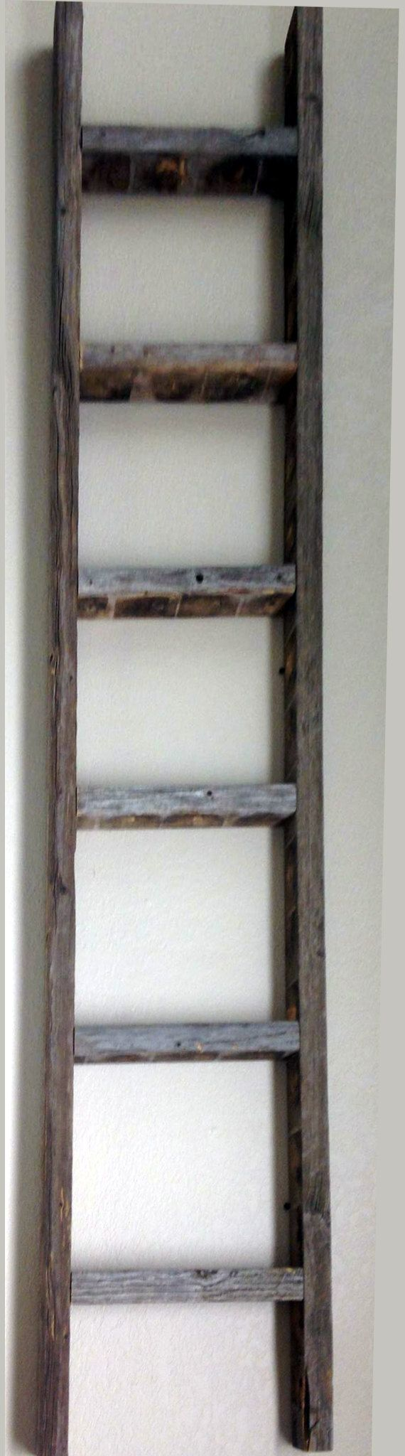This authentic weathered rustic barnwood ladder is made from old 2x3s. There are 6 rungs with a space of 7 high and 12 wide between each rung.