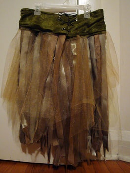 This looks like something that could be customized for a fairy or lost boy or pirate. Wonder if you could take a skirt, tack tule around the waist in layers and shred it to get this effect?
