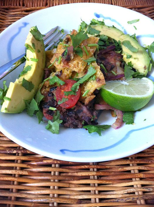plate of vegan chilaquiles with lime and cilantro
