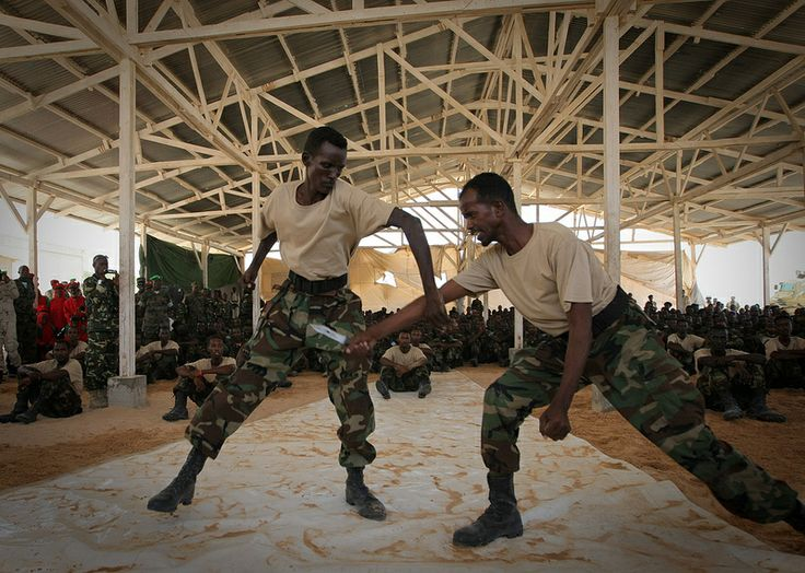 630 troops from different brigades of the SNA were taught and mentored on leadership skills, weapons handling and field military tactics during the two and a half month course, deploying back to their units on the frontline after the ceremony, which was overseen by Somali President Sheik Sharif Sheik Ahmed and senior SNA and AMISOM military commanders. AU-UN IST PHOTO / STUART PRICE.