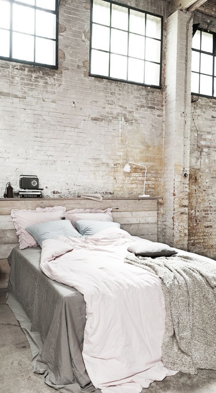 Industrial space bedroom. Exposed brick. LOVE THIS! Great tones and palette