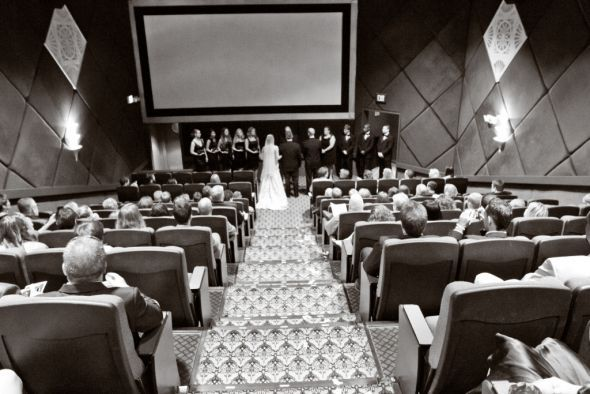 movie theater wedding, everyone has a seat! such a cool idea!! could be done in old local theatre?