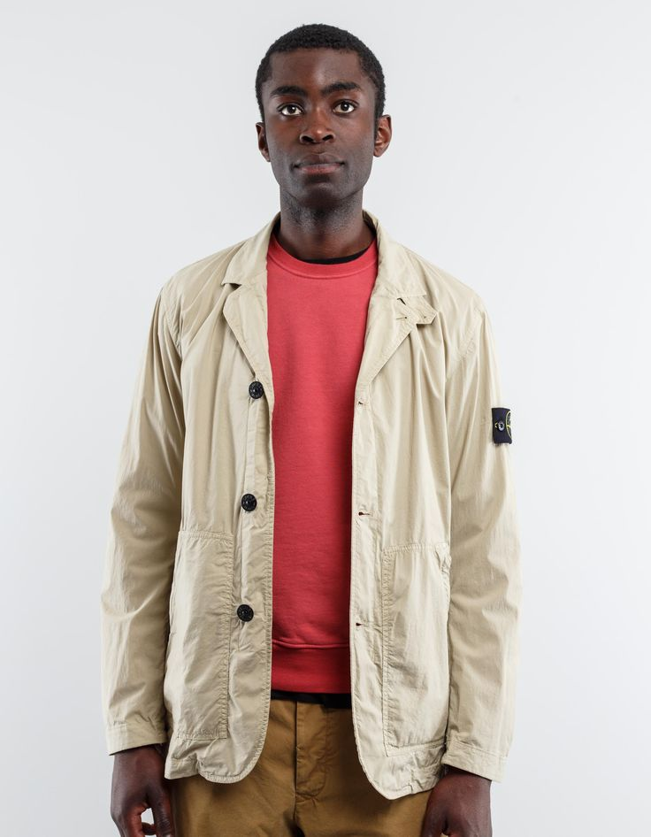 Lt Paracadute Stretch Blazer from Stone Island.    lightweight and compact canvas made from the finest threads of packed super cotton. A small amount elastane lends the fabric added comfort. Garment dyeing gives the fabric a wavy appearance.  Beige 97% Cotton, 3% Elastane  Model is 188 cm tall, measures 88 cm over chest and wears size L.