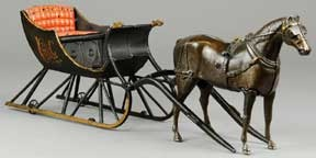 "Ives cutter sleigh with articulated horse, 1890's, cast iron, sculptural lines, in masterful detail, 22"" long, $86,250."