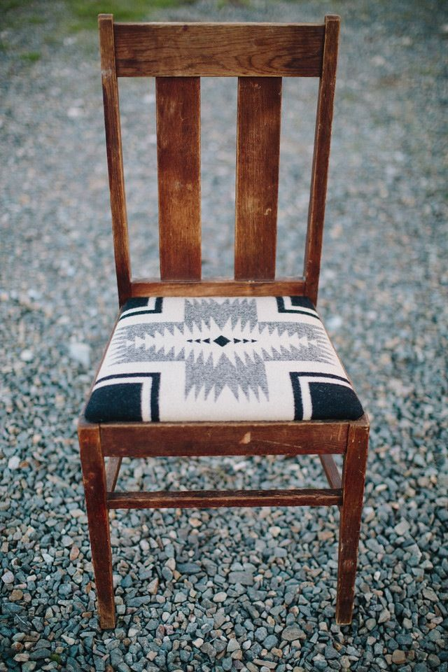 """Turn-of-the-century oak chair, built to last for generations.  An incredibly solid and evocative piece of American history.  Featuring a soft Pendleton wool seat with Navajo motif. 36.5"""" tall, 16.5"""" depth, width at front 17""""    *one-of-a-kind and vintage pieces are non-returnable"""