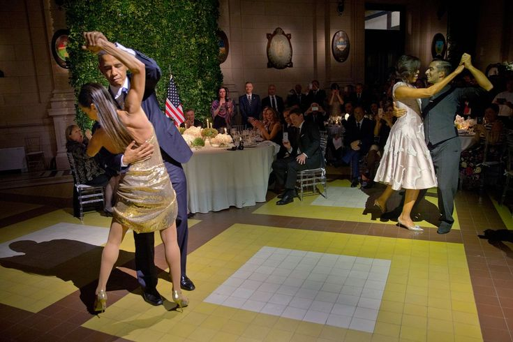 Barack and Michelle Obama tango with professional dancers as they attend a state dinner in Buenos Aires hosted by the Argentinian president Mauricio Macri and first lady Juliana Awada.