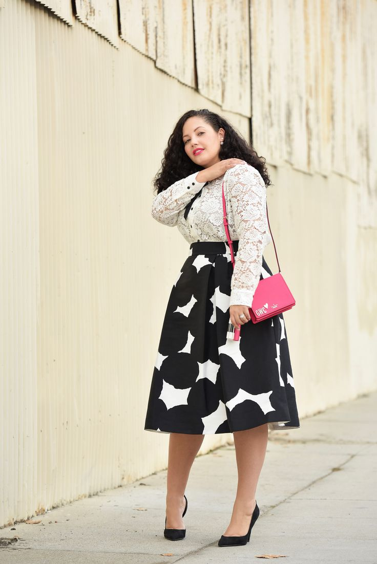 Girl With Curves blogger Tanesha Awasthi wearing a lace blouse and midi skirt from kate spade new york.