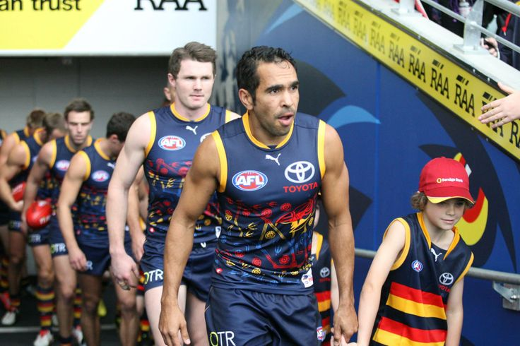 Eddie Betts leading the team out ..Indigenous Round 2014