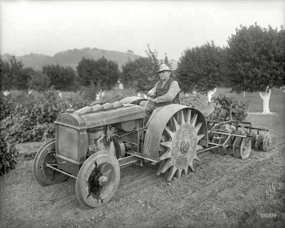 """Oakland, Calif., circa 1918. """"Orchard tractor demonstration -- Fageol Motors Co. 'Walking Tractor'."""""""