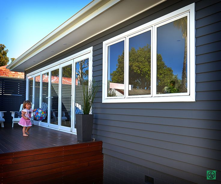 Soak up the open space and embrace the open air, warming sun and ocean breeze #house #cladding #jameshardie #exterior #coastal #australia #linea #weatherboard #contemporary #family #outsideliving