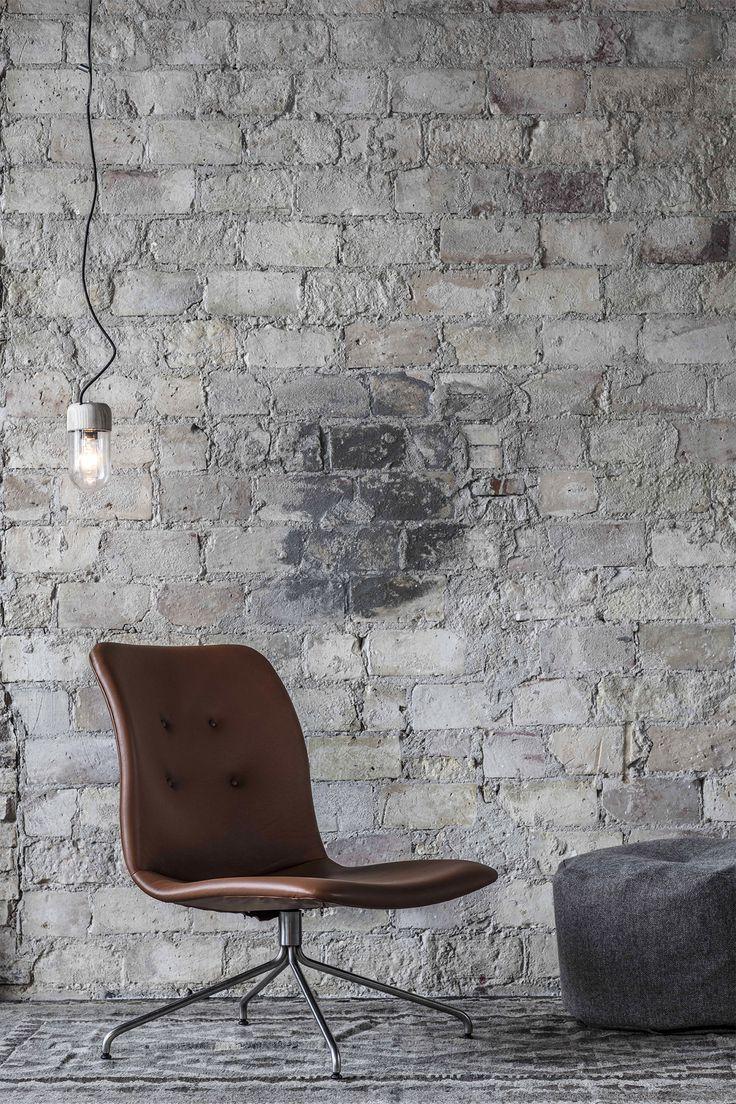 Element Lamp as pendant . Primum Lounge Chair in cognac leather.