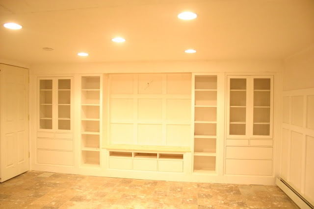 Built in entertainment center using IKEA Hemne pieces (2 bookcases, 2 glass door cabinets, and a TV unit)
