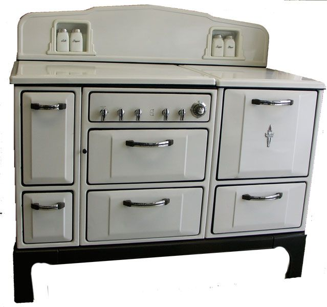 """This 1935 Wedgewood Stove is a unique beauty. It features salt  pepper and sugar  flour shakers, It has a lift-top lid, broiler, and storage."