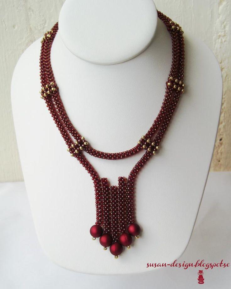 Mina smycken: Vinröd Craw