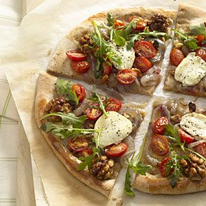 Arugula and Goat Cheese Pizza | This healthy homemade pizza features whole-wheat pizza crust topped with flavorful goat cheese, spicy arugula greens, and halved grape tomatoes. | myrecipes.com