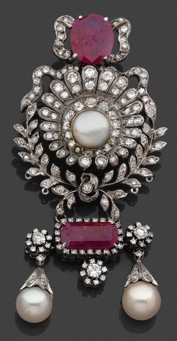 An Antique Platinum, Gold, Ruby, Pearl and Diamond Brooch.