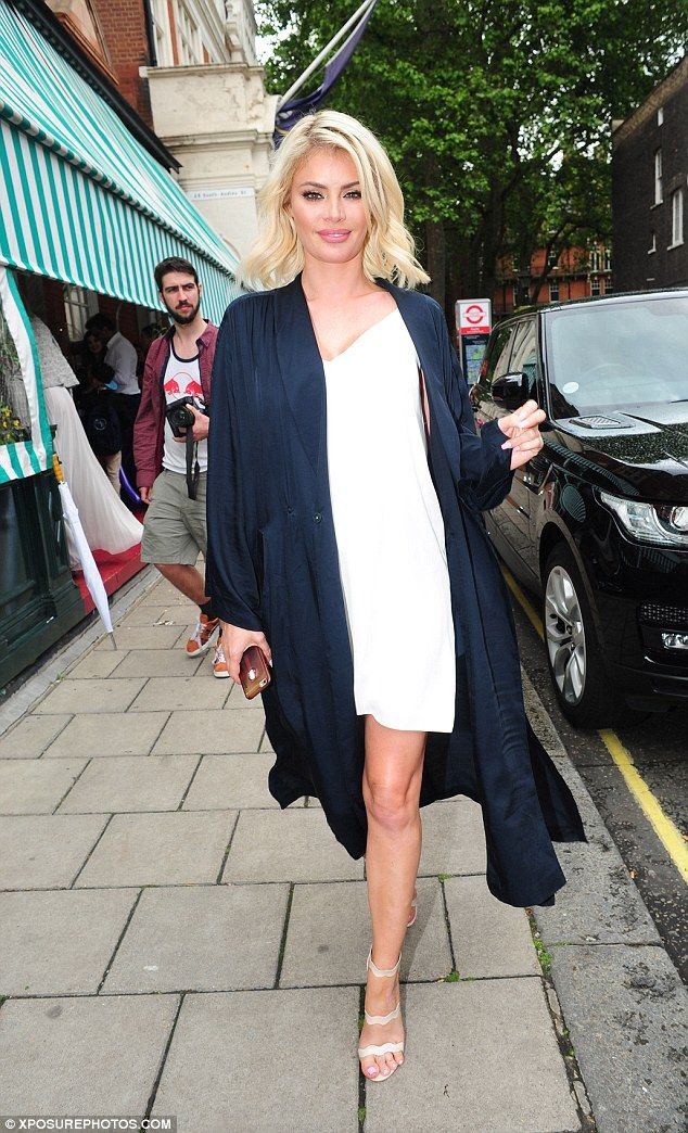 Fun-filled outing: Chloe Sims was once again joined by her multi-millionaire friend Robert Tchenguiz as she partied at Harry's Bar in London on Sunday