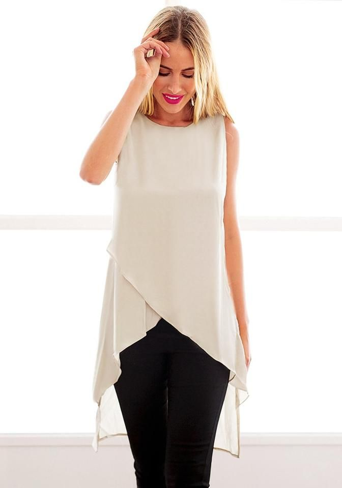 Front view of model in  pink asymmetric tank tunic