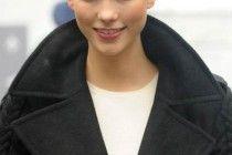 Karlie Kloss Twisted Bun ~ http://www.haircutsforwomen.biz/beautiful-short-haircuts-for-dating/
