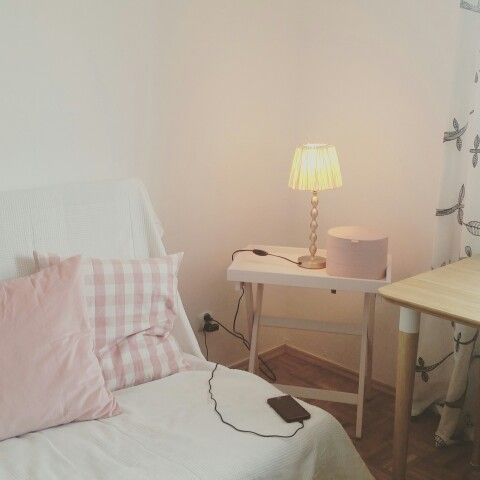 White cosy pinky salmon woody room