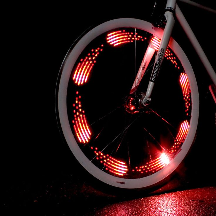 http://www.bellsandwhistles.co.nz/collections/bike-lights/products/monkeylectric-m210-light MonkeyLectric M210 Bicycle Spoke Light, Bike Light. The Monkey light includes 20 themes with hundreds of colour combinations. The 10 LED light board hooks to 2 of your spokes using 3 point zip ties and attaches to a hub-mounted 3AA battery pack. #spokelight #monkeylectric #bicyclelight #bikelight